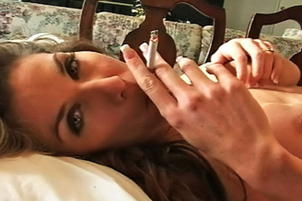 Smoking hot tits1. Kayla plays with her hot tits as the smoke caresses her skin