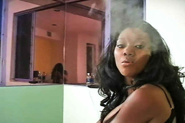 Smoke and mirror. Naomi  smokes while admiring her lascivious dark chocolate body in the mirror