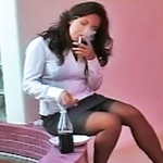 Smoking by the office water fountain. Horny Secretary Zoe Britton enjoys a cigarette by the indoor water fountain