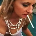 Lana puffs a stiff rod and a cigarette. Lana has smoke drifting from her mouth as she gives a wet wild give suck